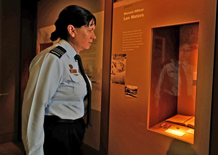 Wing Commander Cheryl Neal viewing the collection at the Australian War Memorial.