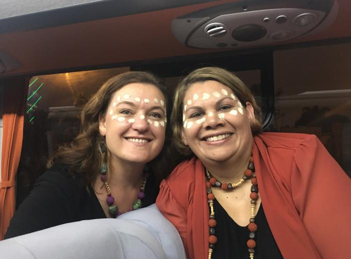 Beth Hall (left) and Dorinda Cox (right) celebrating as part of the APEC Women and the Economy forum's cultural exchange.