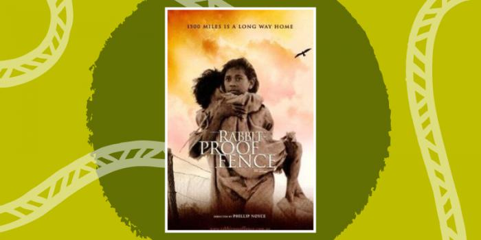 "Movie cover.""1500 Miles is a long way home"" written at the top of the cover. Orange clouds with Two Aboriginal sisters walking past a fence, the elder sister holding the young one. A bird flying above them and the words ""Rabbit Proof Fence"" at the bottom."