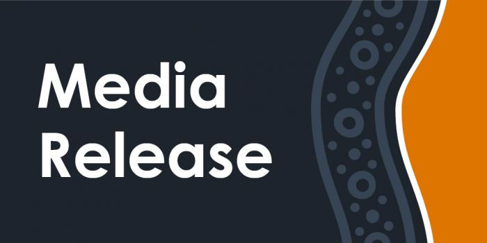 Tile with grey and orange panels separated by tradition design featuring dots, circles and wavy lines. Words at left are: Media Release.