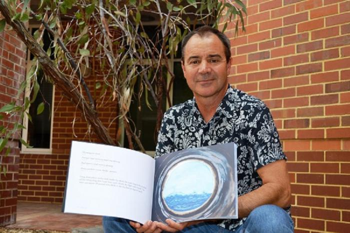Kim Scott, with one of the Wirlomin Noongar Language and stories recently translated stories, Perth, WA
