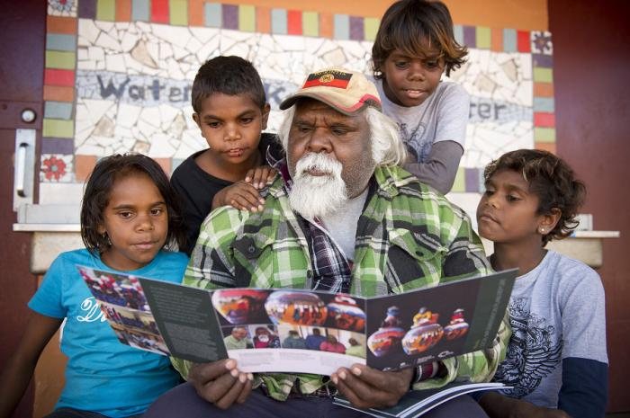 Hermannsburg Indigenous Engagement Officer, Edward Rontji with Ntaria school kids Mahalia Moketarinja, Bowen Abbott, Johannas Kantawara & Ashley Lankin