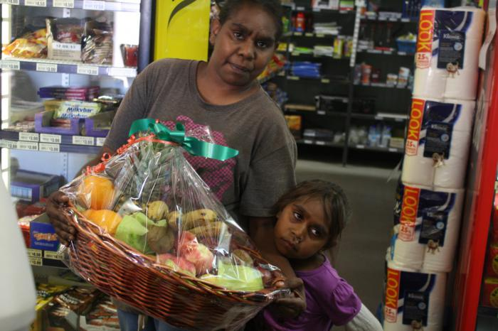 Lorraine Stuart and her daughter Samantha with the fruit basket they won in one of Aputula Community Store's weekly draws.