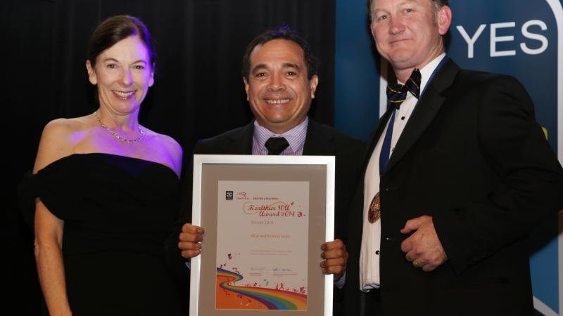 David Pigram, founder of Alive & Kicking Goals!, accepts the AMA (WA) Healthway Healthier WA Award June 2014.