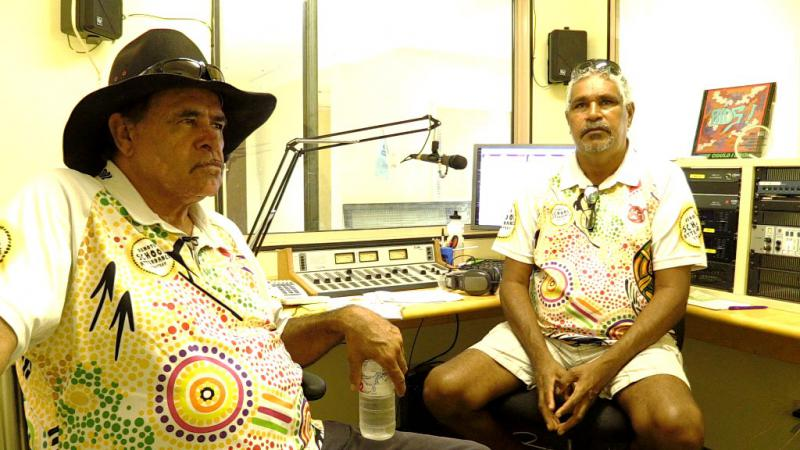 Two Indigenous men in a radio studio.