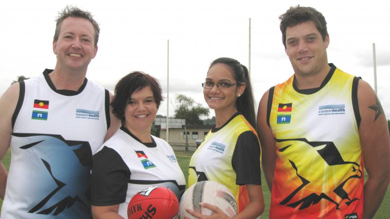 Barry Collins, Jo Voce, Marisa Smiler-Cairns and Jie Smith dressed in sporting uniforms.