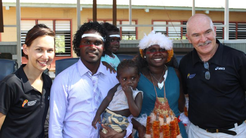 Evelyna Dhamarrandji (second from right), her partner Tyrese Dhurrkay (second from left) and their children, with the Indigenous Marathon Project's Nadine Hunt and Robert de Castella.