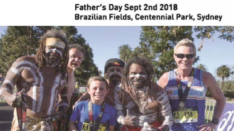 poster featuring 5 men and 1 boy. 4 men are dressed in traditional Indigenous wear and body paint. The other two are in runner clothes. Text on the poster includes Father's Day Festival, Celebrating Great Men, Father's Day Sept 2nd 2018, Brazilian Fields