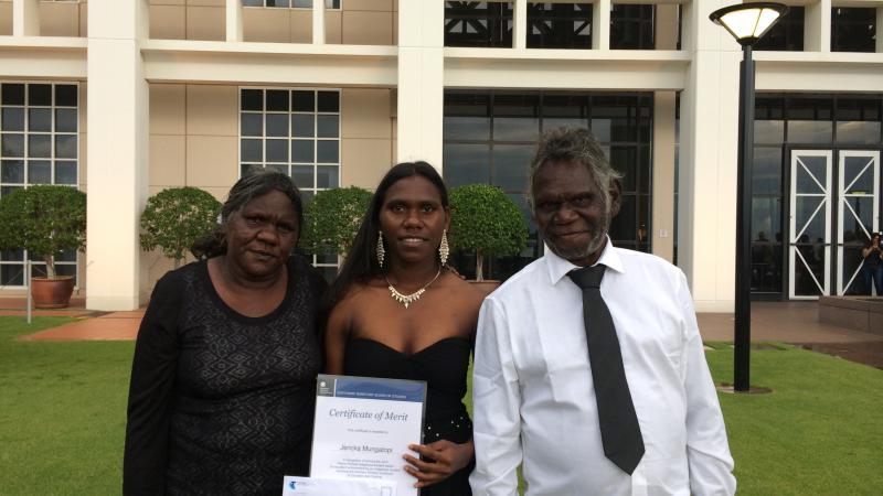 Jericka Mungatopi proudly showing off her award with parents Katrina and Fredrick.
