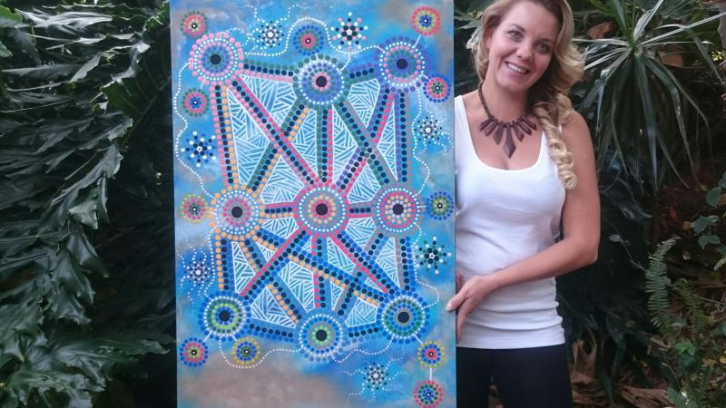 Lani Balzan with her artwork 'Songlines tie all Aboriginal people together'