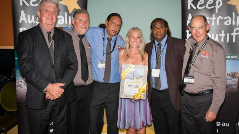 Melvin Malbunka, Chairperson of the Mount Liebig Local Authority (third from left) and Essential Services Operator Jeffrey Wheeler (second from right) with MacDonnell Regional Council staff celebrating Mt Liebig being awarded the inaugural Special Commend