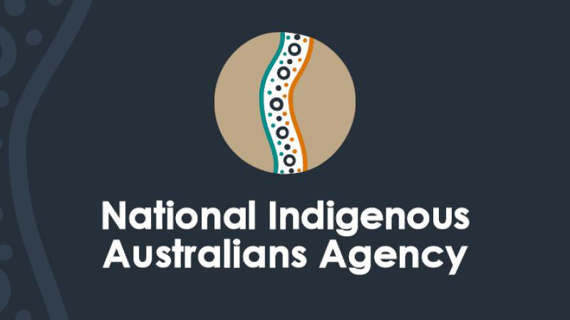 Poster with Indigenous design in a tan disc on a dark blue background. Words at base are: National Indigenous Australians Agency.
