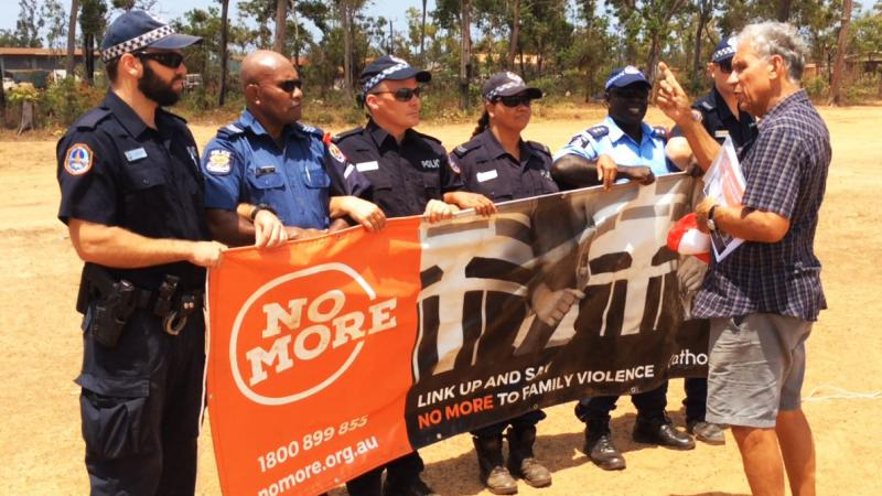 NO MORE campaign founder Charlie King with local police and visiting PNG police at the NO MORE launch in Ramingining