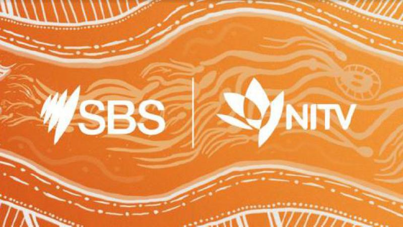 Orange and white logo poster with words: SBS NITV with accompanying station logos.