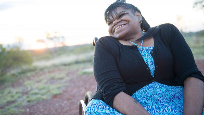 Indigenous woman sitting in a wheel chair.