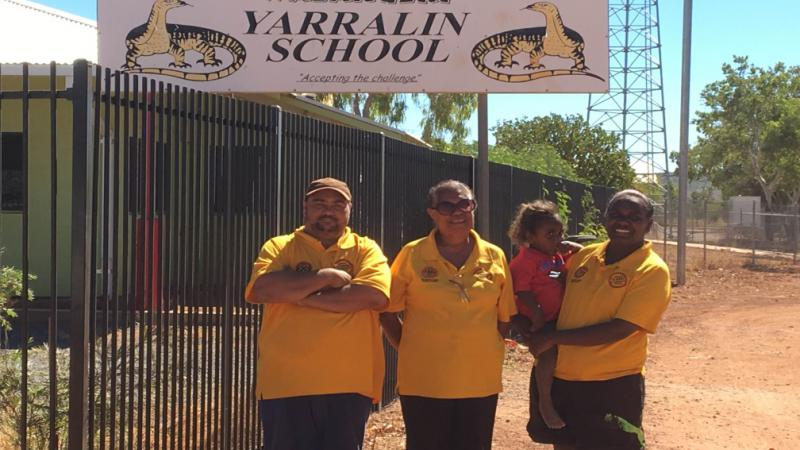 Yarralin Remote School Attendance Team: L-R; Simon Campbell, Frances Rosas and Jasmin Campbell (SAO), with Jasmin's daughter, Ameera.