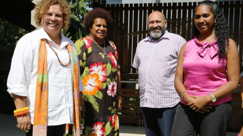 Three Indigenous women and one Indigenous man stand together outside, at the launch of the Torres Strait and Kaurareg Aboriginal Peoples' Healing Strategy.
