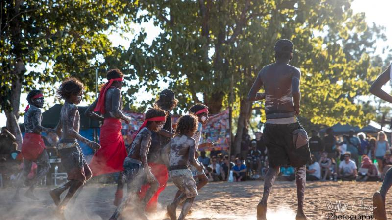 Children in traditional outfits dancing on country at the Barunga Festival.
