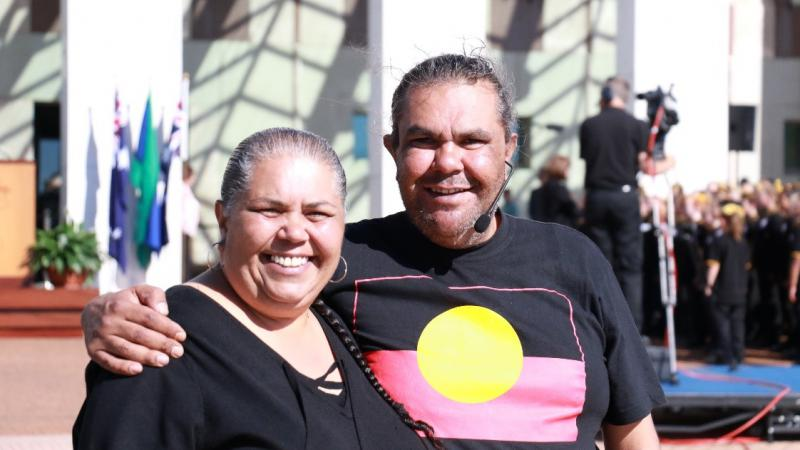 Aunty Tina and Uncle Adrian stand proudly outside Parliament House after the Welcome to Country and smoking ceremony.