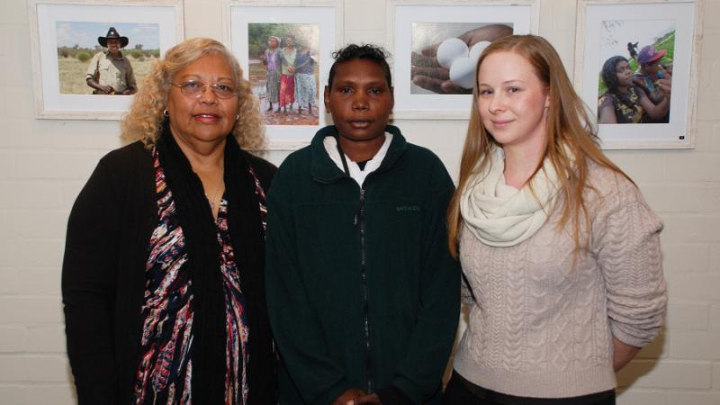 "Chrissy Grant, Wanggawuy ""Grace"" Mununggurritj and Amy Rayner with some of the Working on Country Exhibition photos"