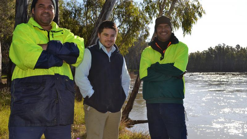 Caring for Our Country project officer Neil Morris (centre) with Woka Wolla team members Wayne Baksh and Harry Wilson on the Murray River, VIC.