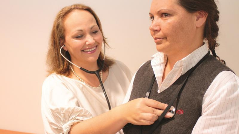 Dr Alanna Sandell conducts a routine health test on Ngarda employee Mel Kelly, Perth, WA.