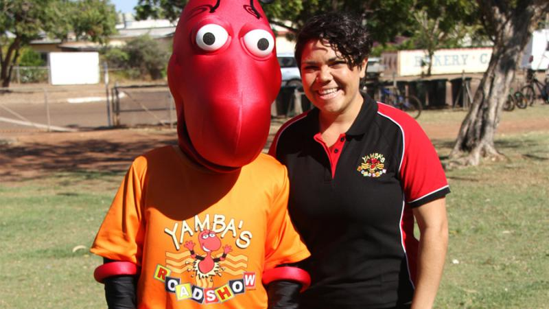 Jacinta Price and Yamba the honey ant, from Imparja's Television's preschool program Yamba's Playtime.