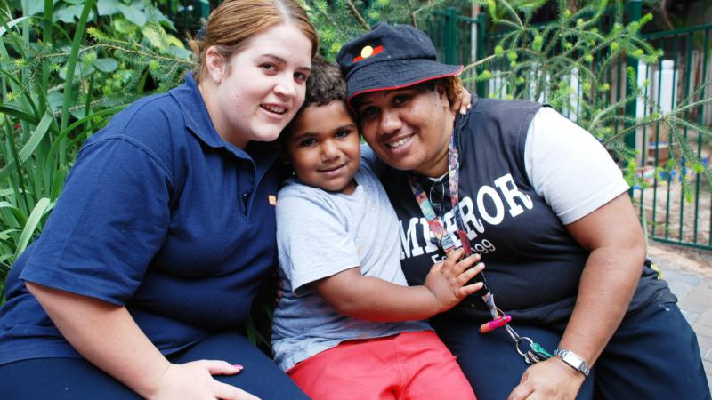 SDN Redfern Koori workers Kayeleigh Smith (left) and Judy Jarrett (right) with Judy's grandson Manduman, who is enrolled in the SDN preschool program.
