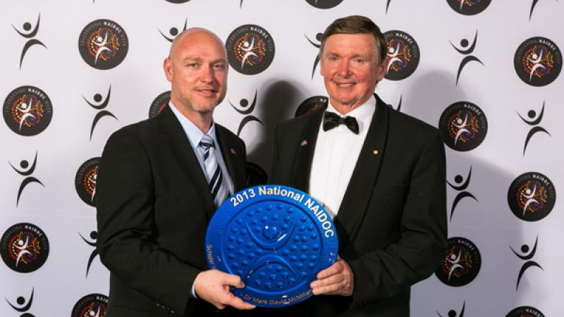 2013 NAIDOC Scholar of the Year, Dr Mark McMillan, with award presenter Western Australian Governor Malcolm McCusker.