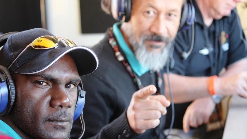 Broadcaster Joel Mamarika and his mentor Percy Bishop working in CAAMA's mobile radio studio, Ntaria, NT.